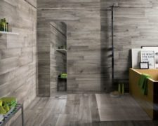 dark-grey-wooden-floor-and-wall-tiled-room-with-green-accents-600x438